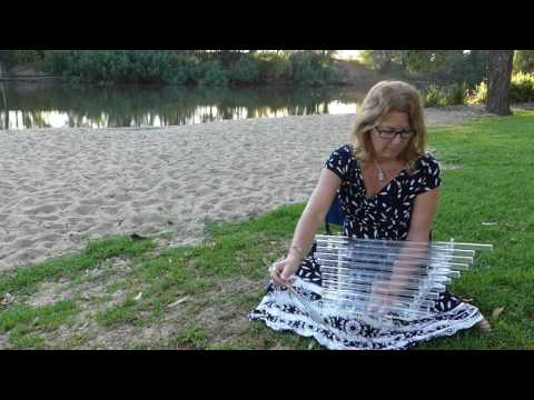 Julia Smith plays Harp of Transformation at Wagga Wagga Beach outback Australia 27 March 2017