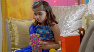 Cute Indian girl in serious mood tapping her fingers on her gift