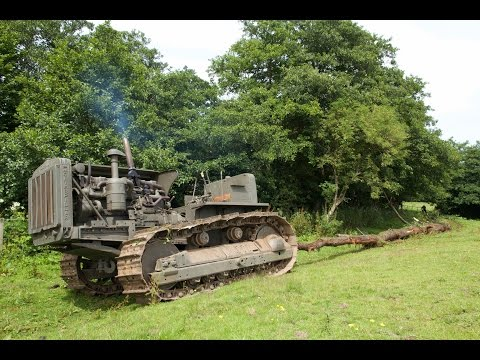Caterpillar D8 bulldozer hauling out 100 foot tree and pony motor start