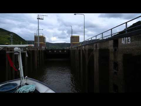 Time lapse of river boat going through lock 2