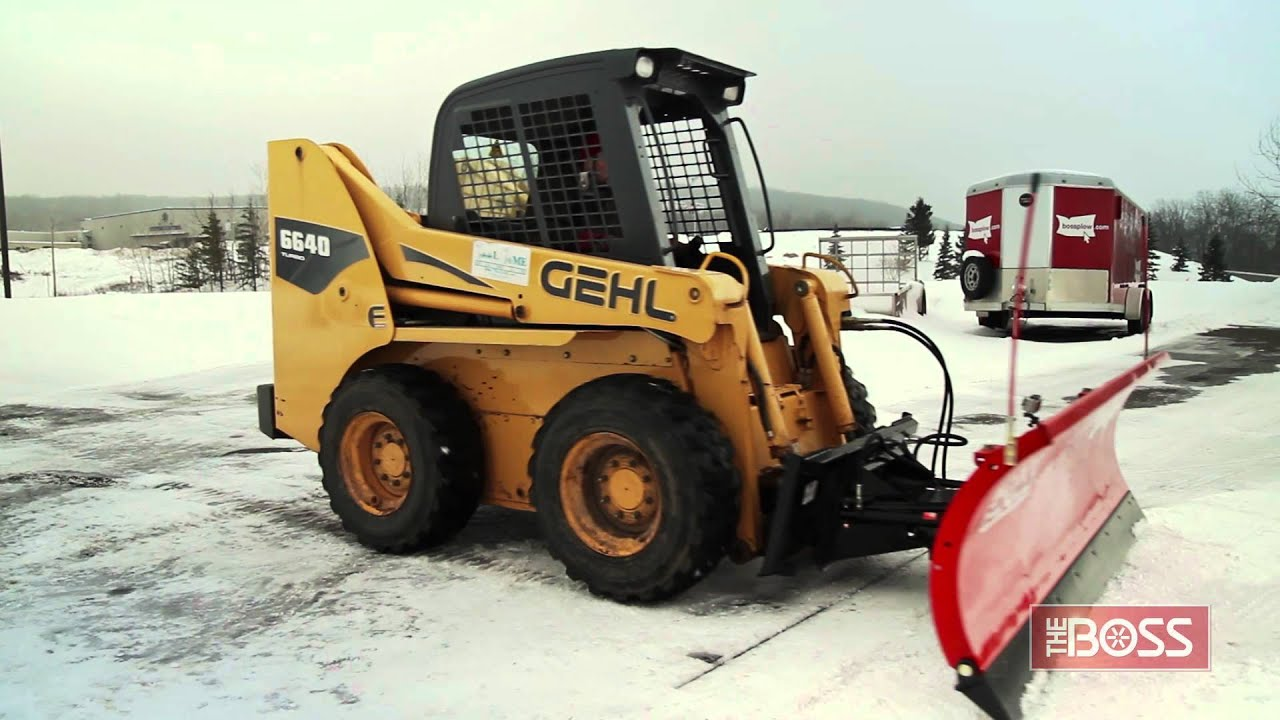 medium resolution of the boss skid steer plow in action
