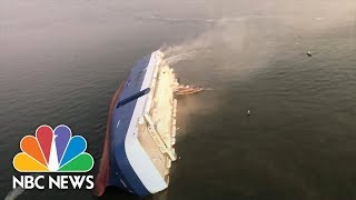 Video Shows Huge Capsized Cargo Ship | NBC News