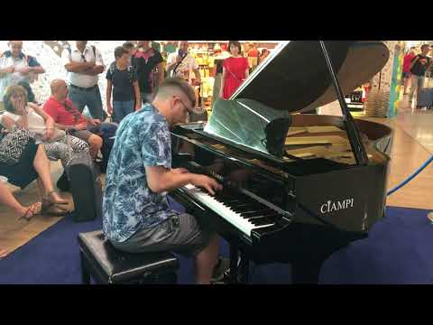 Playing piano in a Roman Airport [Kyle Landry]
