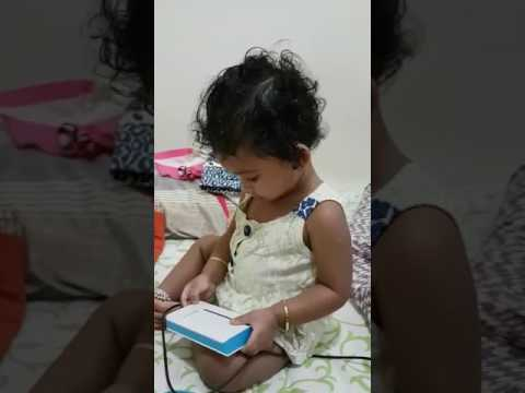 Janu using power bank as fone 16 months old