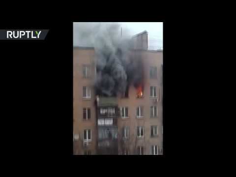 Dramatic escape: Woman survives 8th floor plunge from burning Moscow flat