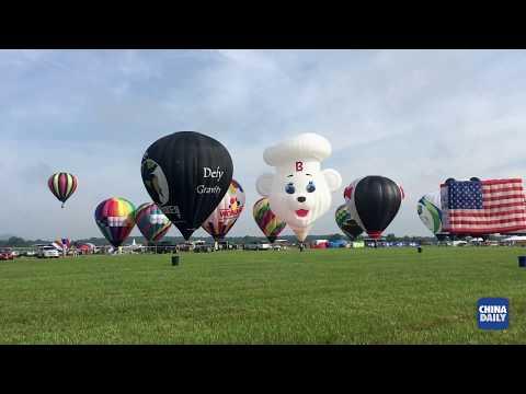North America's largest hot air balloon festival showcases a 110-foot-tall panda