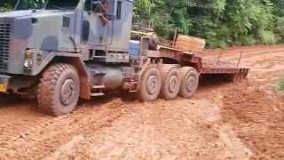 Download Climbing the slippery mountain with the Oshkosh M1070 in worse conditions Mp3 and Videos
