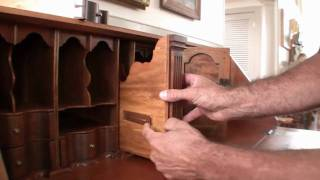 John Friel shows off an intricate cherry secretary desk with hidden compartments and amazing wood grain.