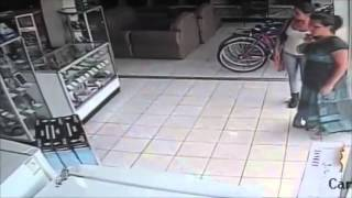 VIDEO: Woman Steals TV Under Her Skirt in Only 13 Seconds