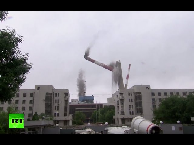 China's local authorities demolish power plant towers as 'contribution to improve air quality'