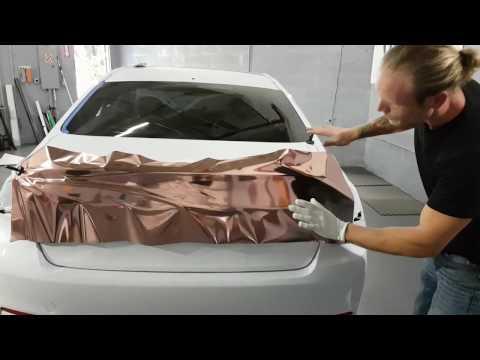 Rose gold chrome. How to chrome vinyl wrap a trunk. By @ckwraps www.ckwrapsmiami.com