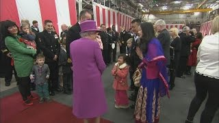 Girl tells Queen 'I like the gloves' during tour of HMS Ocean