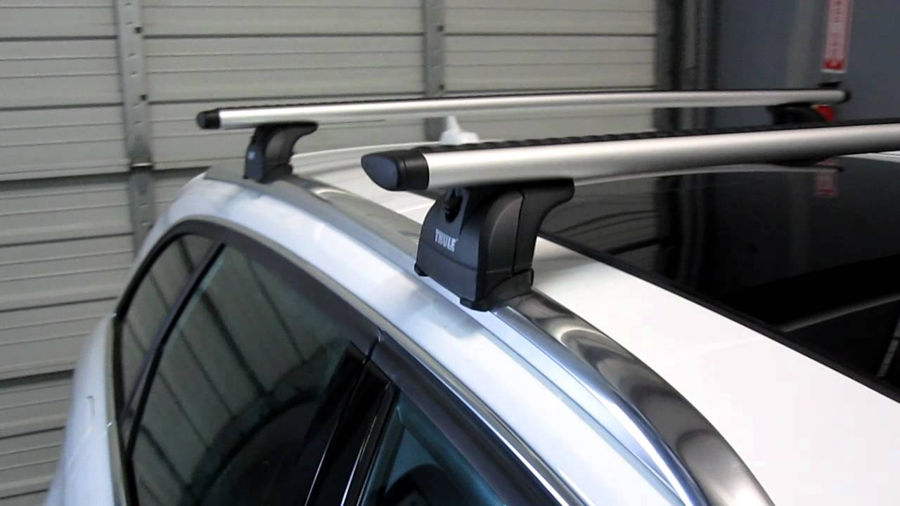 2012 audi a4 avant with thule 460r podium aeroblade base roof rack by rack outfitters