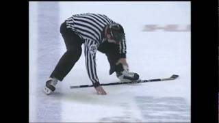 hockey official slips on ice