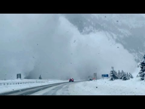 Colorado avalanche covers cars on highway