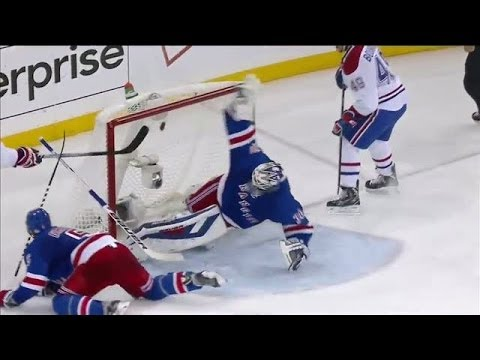 Lundqvist makes a twirling blocker save