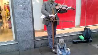 Irish busker with mad puppet in aberdeen