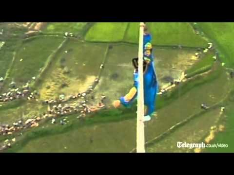 Acrobat Falls Off Tight Rope In Defying High Wire