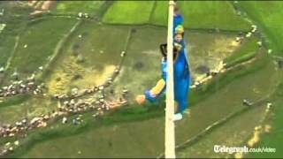 Acrobat falls off tight-rope in death defying high wire stunt gone wrong