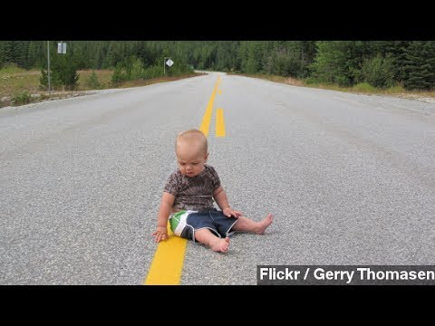 Baby Crawling Across Busy Street Rescued By Motorist