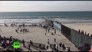 Dozens of migrants climb border fence near Tijuana, Mexico thumbnail