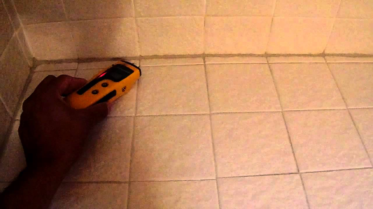 High moisture levels under tile shelfseating area of hallway bath high moisture levels under tile shelfseating area of hallway bath plymouth home inspection dailygadgetfo Choice Image