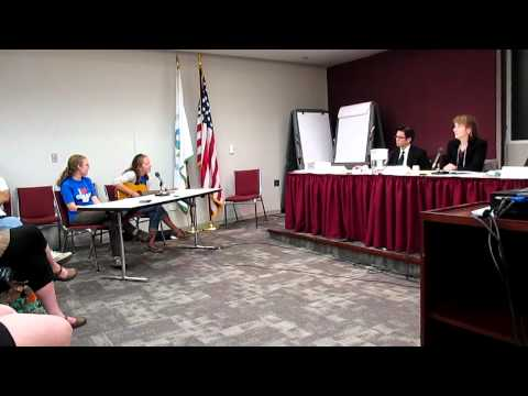 Caroline sings to the US EPA Carbron Rule Hearing Panel