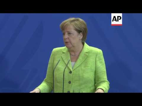 Merkel on China's climate commitment, NKorea