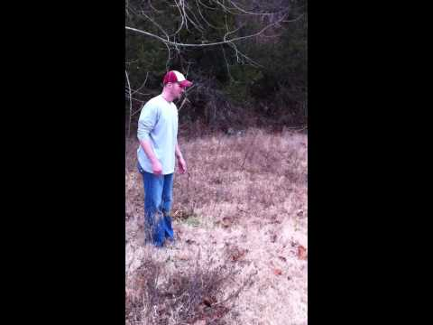 John Akins jumps over a creek