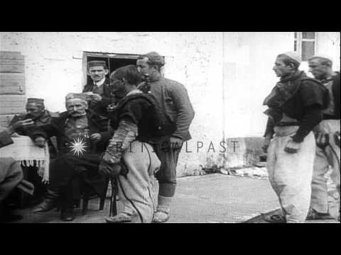 Albanian troops line up to receive money and ammunition certificates HD Stock Footage