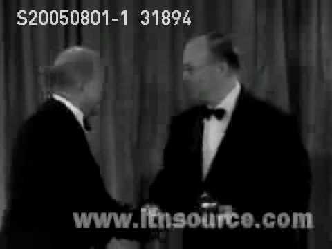 Olivia de Havilland, Anne Baxter and Harold Russell winning their Oscar