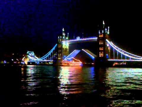Tower Bridge opening while lit up at night
