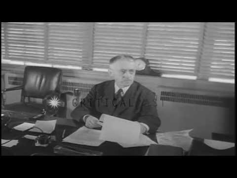 US Secretary of War Henry Lewis Stimson seated at a desk in his office in Washing...HD Stock Footage