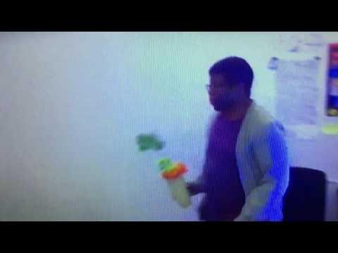Ian Jones-Quartey throws a flower pot at the wall