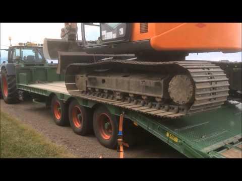 Loading digger onto Agrihire low loader