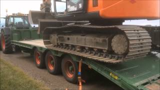 Loading digger onto Agrihire low loader