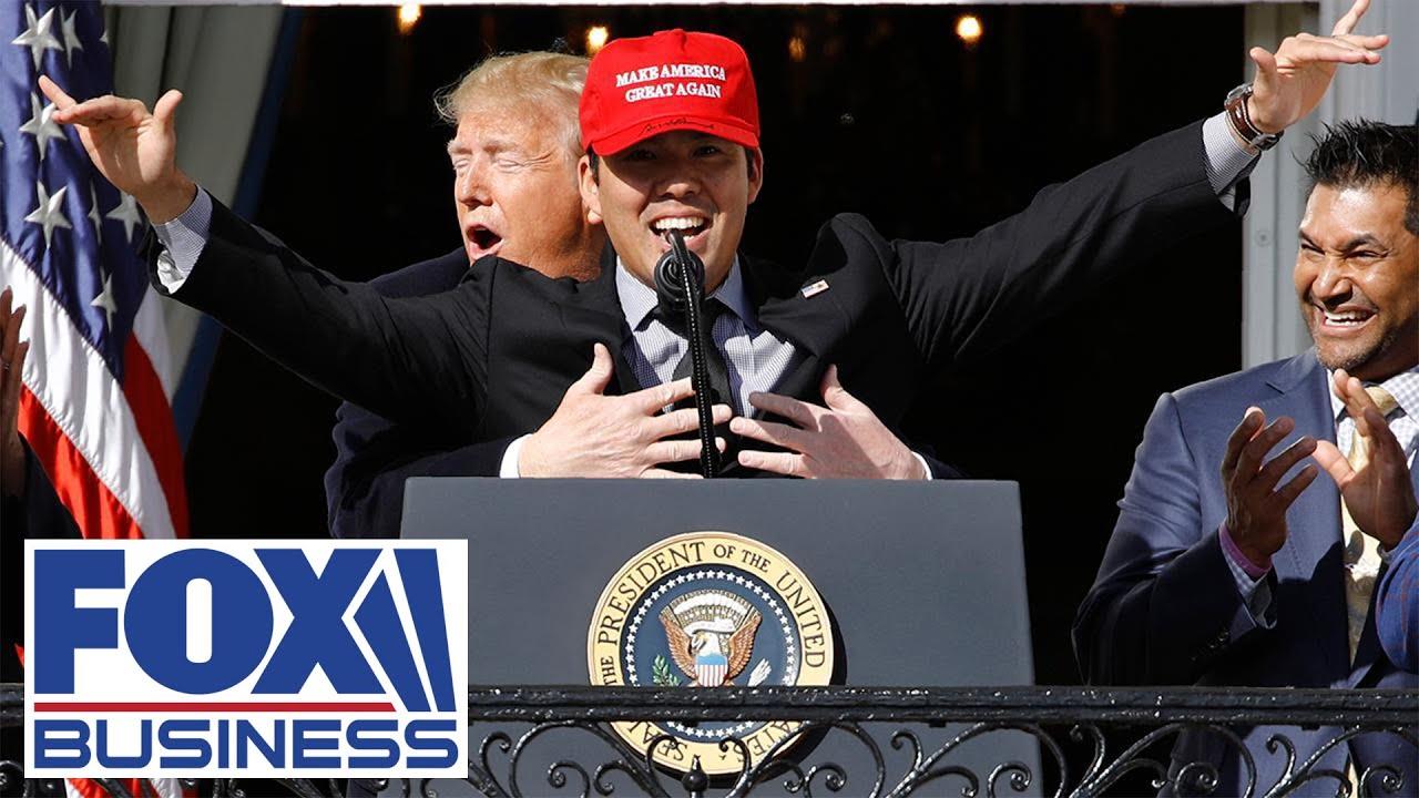 Nationals' Suzuki wears 'MAGA' hat, gets hug from Trump at White House