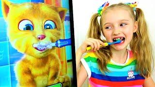 Polina juega con un gato rojo