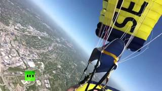 Head-spinning, heart-stopping: US Navy parachute into stadium