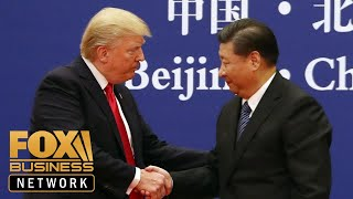 China official blames trade war on US as talks resume