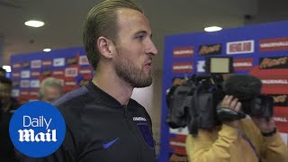 England captain Harry Kane plays darts in Russia