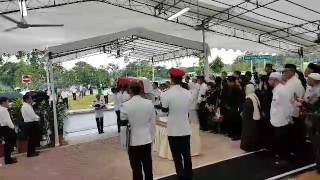 Casket bearing the late Othman Wok arrives at Choa Chu Kang Muslim Cemetery
