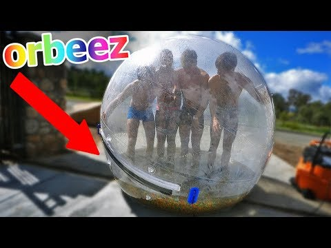 Giant ZORB ball with 2,000,000 ORBEEZ & 4 people VS steep HILL!