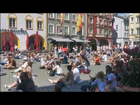 Germany  humans protest and applauding to the rest of the world, asking to join them.