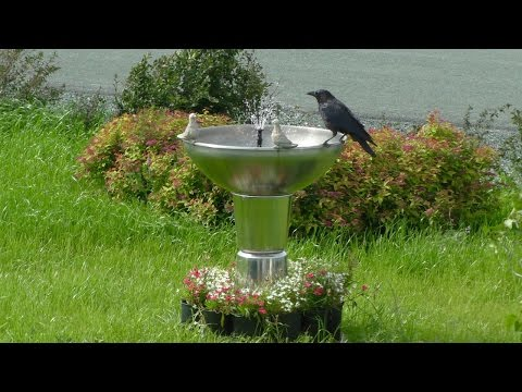 Fountain made from buckets and bowls has automatic water resupply