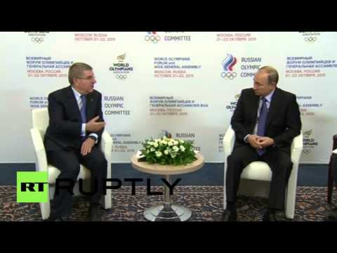 Russia: Putin meets with IOC President Thomas Bach in Moscow