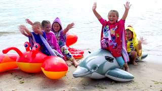 Funny kids play and dance on the sea