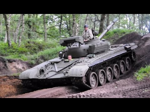 Russian T-72 tank driving it the forest