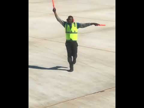 Airport employee dancing on the tarmac