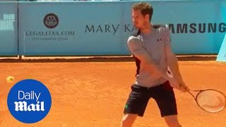 Andy Murray warms up for the Madrid Open - Daily Mail